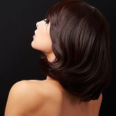 Beautiful Glamour Woman Looking With Nude Back. Closeup