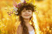 Happy Cute Girl Wearing A Wreath Of Flowers