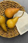Three Pears In Rustic Basket