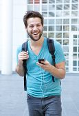 Cool Guy Walking In The City With Mobile Phone