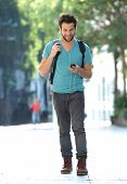 Young Man Traveling With Bag And Mobile Phone