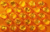 Orange Package Of Pills Tablets Drug Medicine As Background