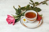 Cup Of Tea On The Table With Rose And Strawberries