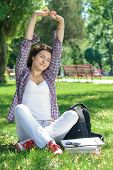 Woman Is Sitting On The Grass