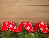 Red ribbon with white stars on wooden background