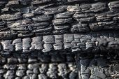 Close Up Of The Wooden Planks Charred After The Fire