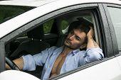 Tired Gorgeous Man Driving His Car