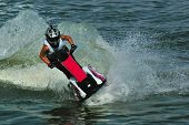 riding a jetski in water drops