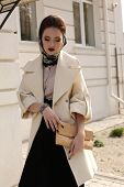 Beautiful Ladylike Woman In Luxurious Beige Coat With Accessories