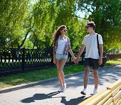 Urban Couple Teen In Love Walking In The Summer Park