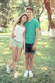 Vintage Summer Portrait Modern Couple Teenagers In The Park, Young Slim Girl With Handsome Boyfriend