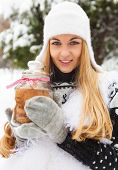 Smiling Woman Holding Cookies Jar In Her Hands