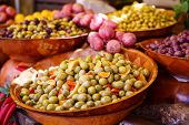 Marinated Garlic And Olives On Provencal Street Market In Provence, France.