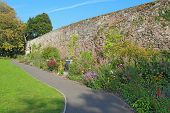 Part of the city wall in Northernhay Gardens, Exeter, Devon, UK