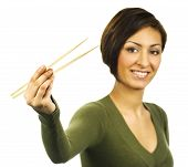 Young Woman Holding Chopsticks With Nothing Between Them