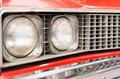 Close Up Of Headlight Of Red Classic Car