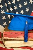 blue graduation cap with flag
