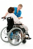 nurse with a senior patient in wheelchair