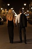 picture of boys night out  - A chic woman and elegant man in a city at night - JPG