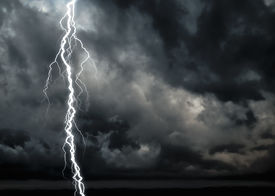 picture of lightning-rod  - A dark cloudy sky with lightning  - JPG