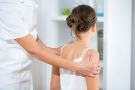 stock photo of chiropractor  - Chiropractor doing adjustment on female patient at the doctor - JPG
