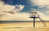 image of lifeguard  - Vintage retro style filtered picture of a lifeguard tower on a beach - JPG