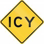 image of icy road  - US warning traffic sign - JPG