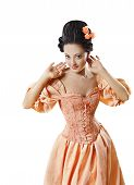 stock photo of flirt  - Woman in Historic Baroque Costume Corset Girl in Rococo Retro Style Dress Flirting Isolated Over White Background - JPG