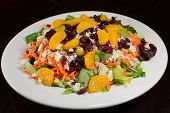 stock photo of shredded cheese  - Salad on a plate made with mandarin slices - JPG