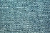 picture of ripped  - Ripped blue jeans closeup texture and background - JPG