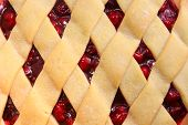 pic of cherry pie  - Close of of the lattice of a freshly baked cherry pie - JPG