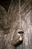 image of roof-light  - A light bulb hangs from the roof of a mosque in Cairo - JPG