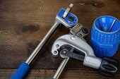 pic of bender  - Tube bender or pipe bender tools on wooden background - JPG