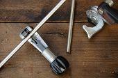 stock photo of bender  - Tube bender or pipe bender tools on wooden background - JPG