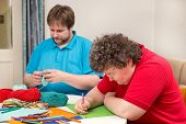 stock photo of arts crafts  - a mentally disabled woman and young man doing arts and crafts - JPG