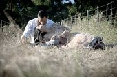 stock photo of indian beautiful people  - Beautiful young Indian couple relaxing outdoors in long grass - JPG