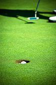 Golf ball hit the hole