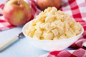 stock photo of custard  - Apples with vanilla custard in a bowl - JPG