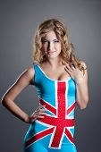 stock photo of union  - Image of cute female dancer posing in costume with Union Jack - JPG