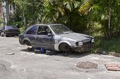 picture of junk-yard  - Car broken crumpled and abandoned in Sao Paulo city - JPG