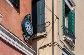 pic of analog clock  - Outdoor analog wall street clock in Venice Italy - JPG