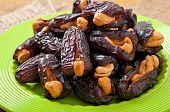 stock photo of lenten  - Oriental sweets - sun dried dates stuffed with cashew ** Note: Shallow depth of field - JPG