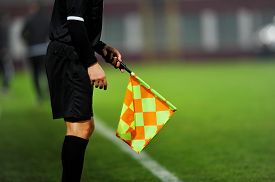 pic of umpire  - Assistant referees in action during a soccer match - JPG