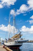 stock photo of curacao  - A schooner docked in colorful Curacao under blue skies - JPG