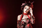 image of geisha  - Portrait of an attractive geisha with bright makeup and hairdo - JPG