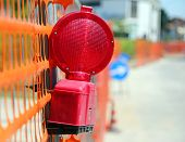 pic of excavator  - Road yard with red signal lamp on road excavation - JPG