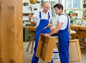 stock photo of dungarees  - two worker in blue dungarees in a carpenter - JPG