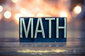 foto of math  - The word MATH written in vintage metal letterpress type on a soft backlit background - JPG