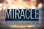 stock photo of revelation  - The word MIRACLE written in vintage metal letterpress type on a soft backlit background - JPG