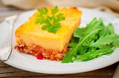 stock photo of mashed potatoes  - A Slice of Mashed Potato Pumpkin and Tomato Minced Meat Bake - JPG